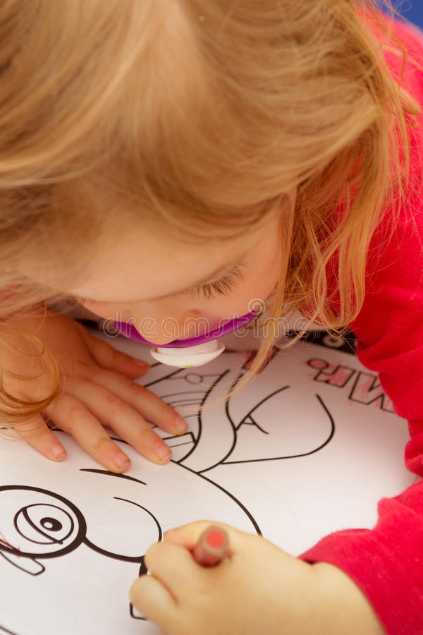 Young girl drawing royalty free stock photos