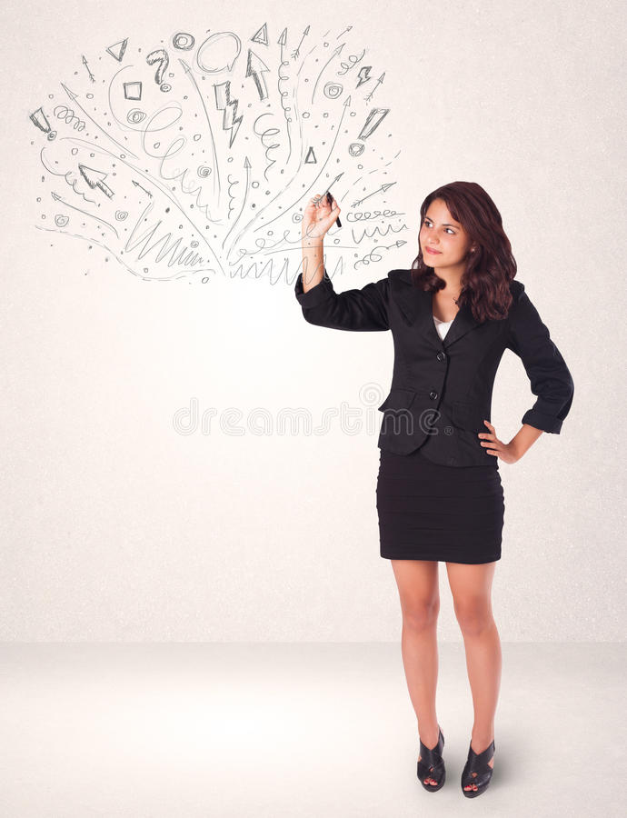Young girl drawing and skteching abstract lines stock image