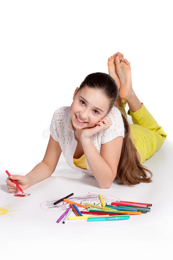 Young girl draws stock photo