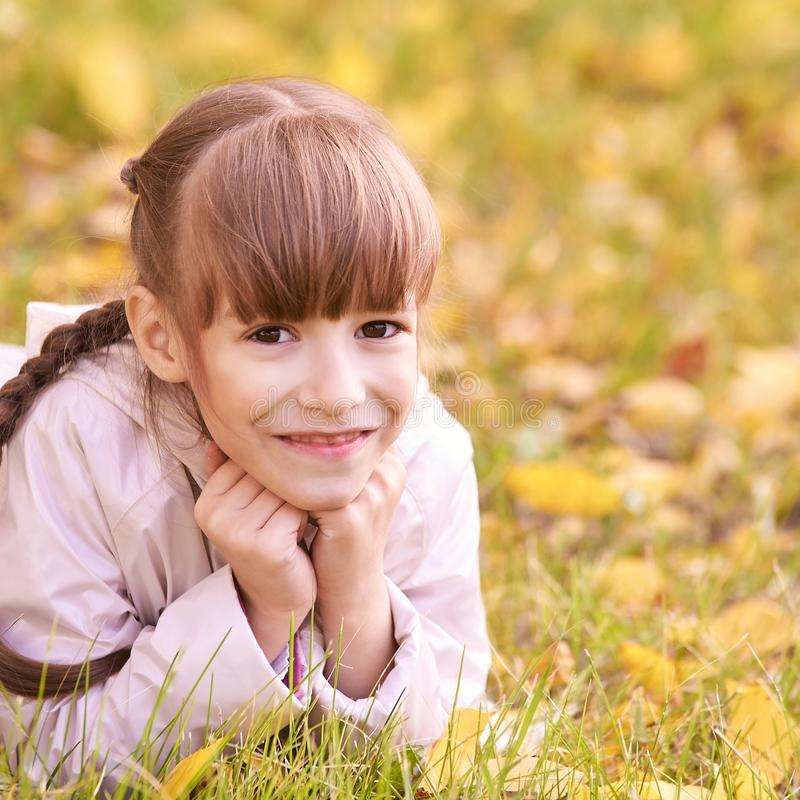 Young girl dream. Autumn background. Pretty smile royalty free stock image