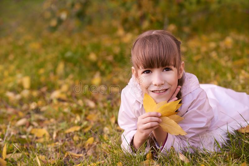 Young girl dream. Autumn background. Pretty smile royalty free stock images