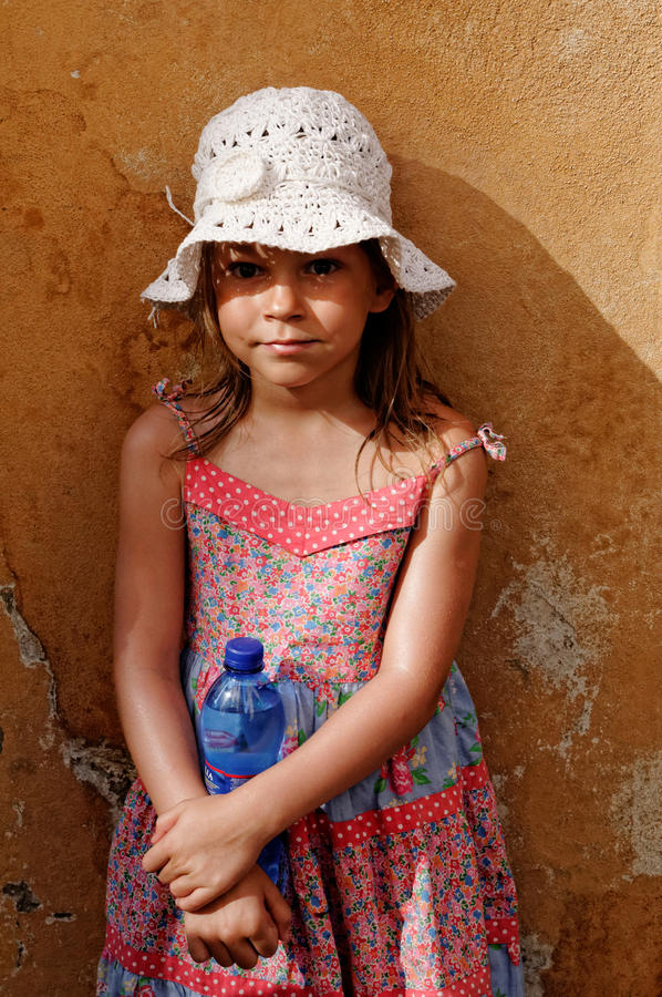 Young Girl In Dress And Hat Royalty Free Stock Photo