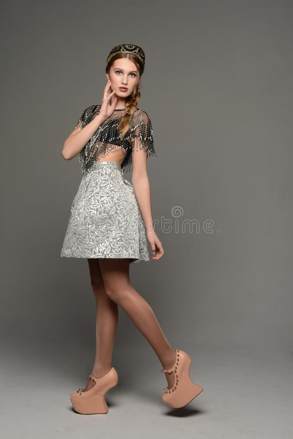 Young girl. In the dress a la rus royalty free stock image