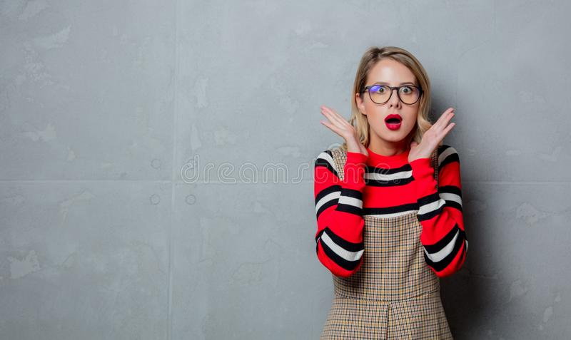 Young girl in dress and striped sweater stock photography