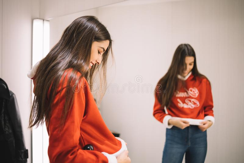 Young girl dress up a new Christmas sweater stock image