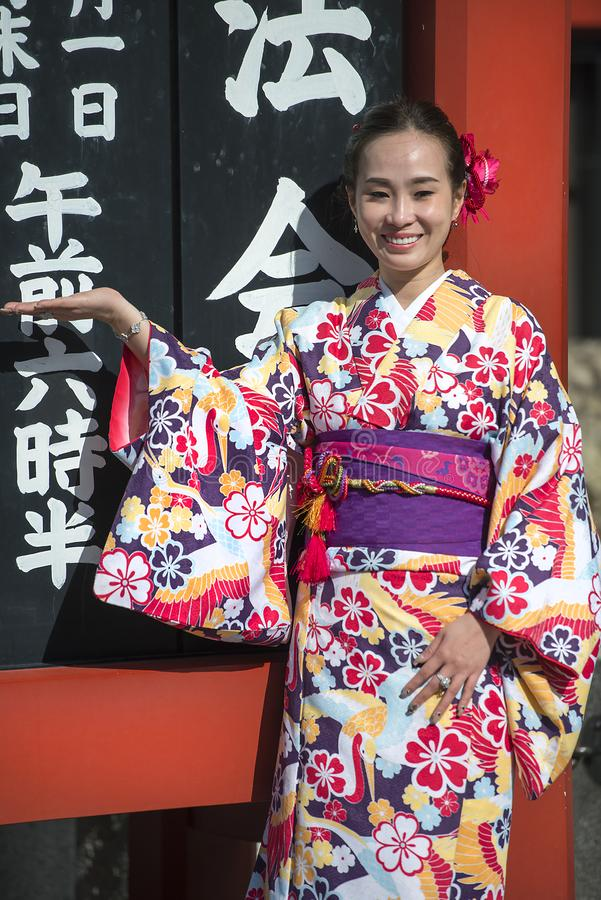 Young girl dressed in traditional japanese clothing kimono stock image