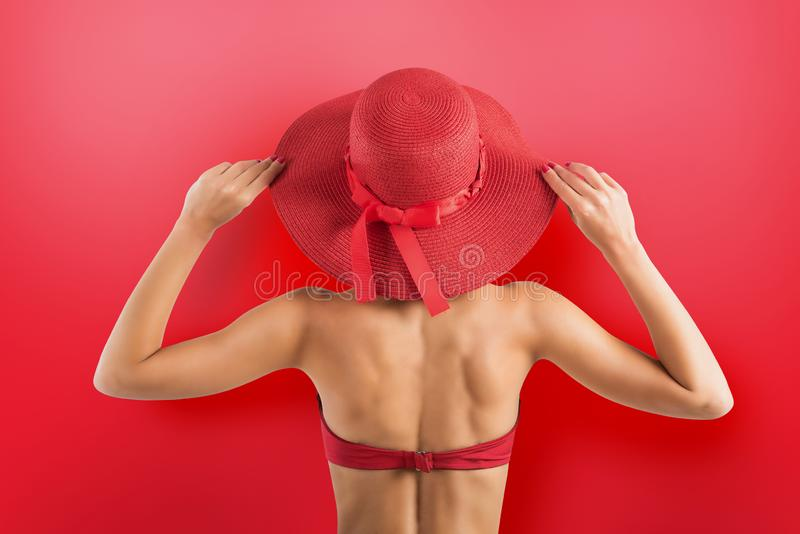 Girl dresses a swimsuit and hat in red style royalty free stock image