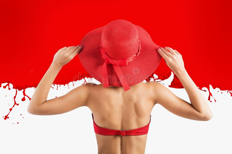 Girl dresses a swimsuit and hat in red style stock images