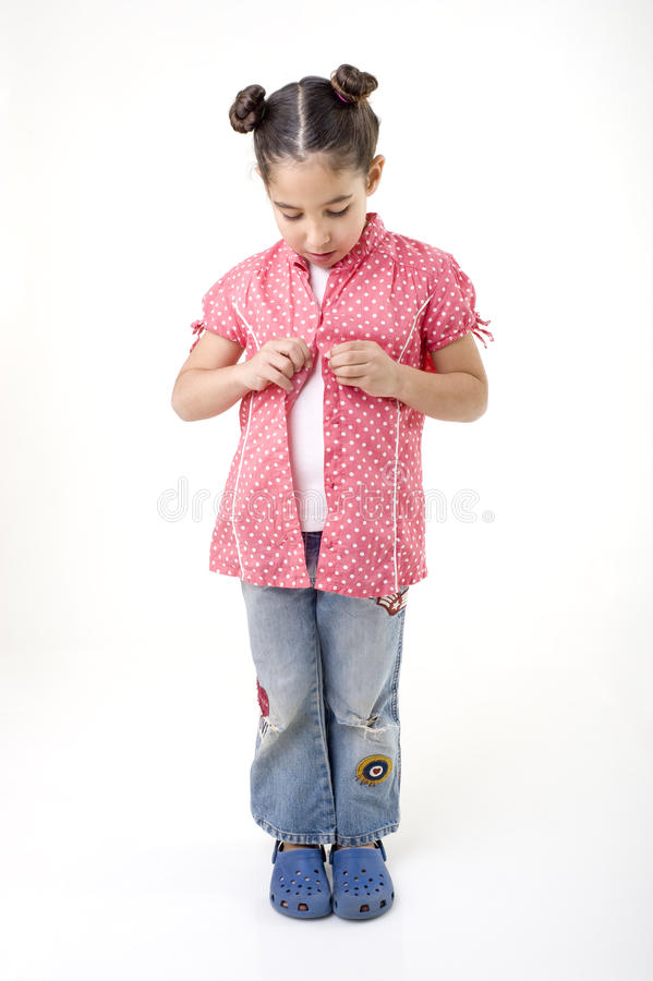Download Young girl dressing stock image. Image of wear, undress - 12577309