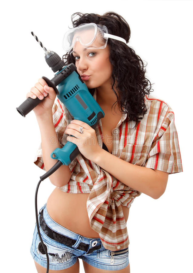 A young girl with drilling machine stock photography