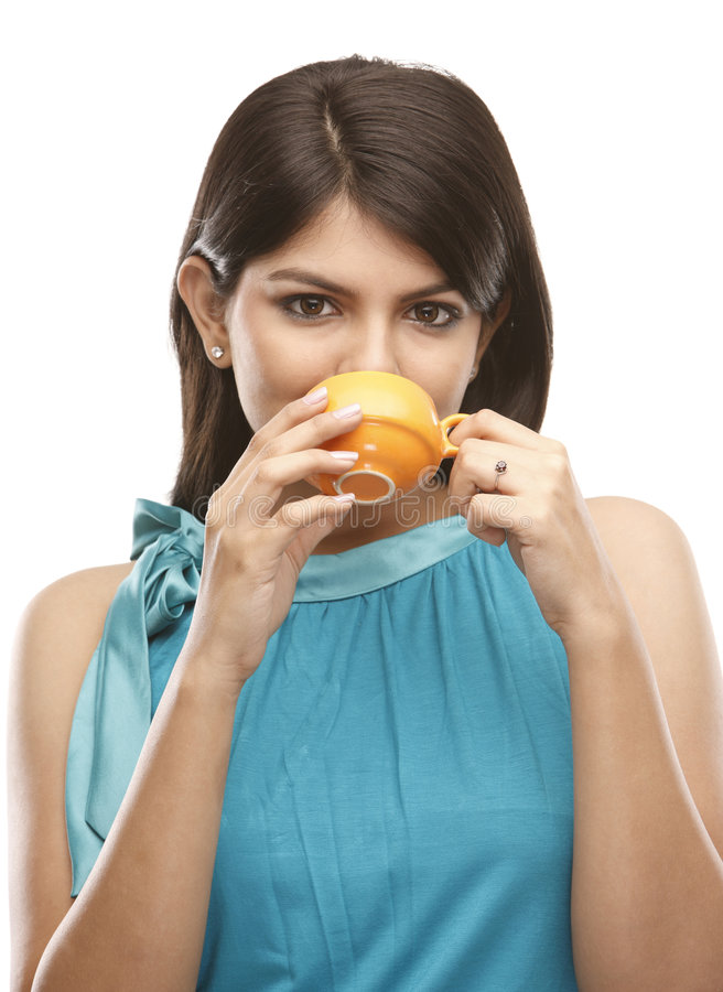 Young girl drinking coffee royalty free stock photography