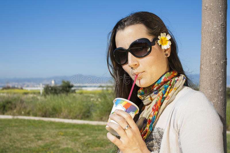 Young girl drinking soda with a straw royalty free stock image