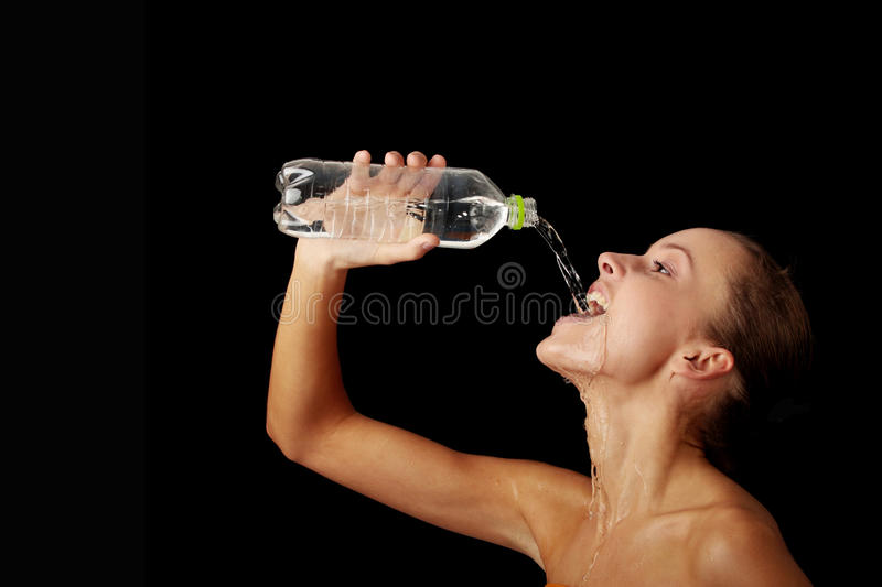 Young girl drinking water from a bottle royalty free stock image
