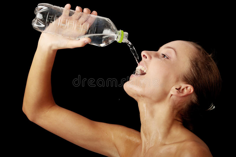 Young girl drinking water from a bottle stock photos