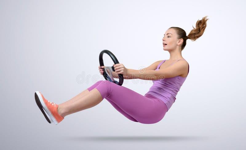 Young girl driver car with a wheel, auto concept.  stock photo