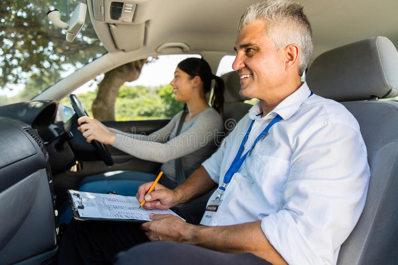 Young girl driving test stock images