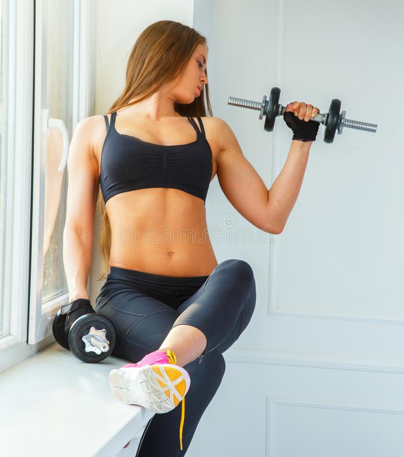 Young girl with dumbell stock photo