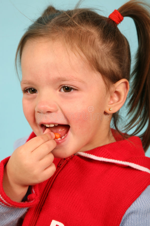Young girl eating stock photos