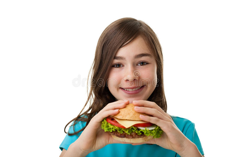 Young girl eating big sandwich. Young girl eating healthy sandwich isolated on white background stock photos