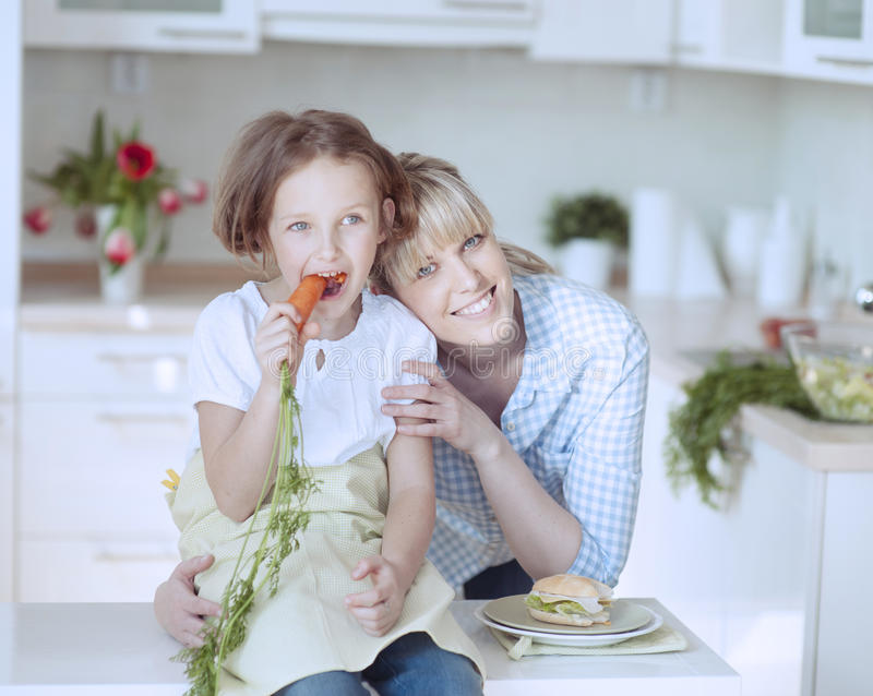 Young girl eating carrot stock photo
