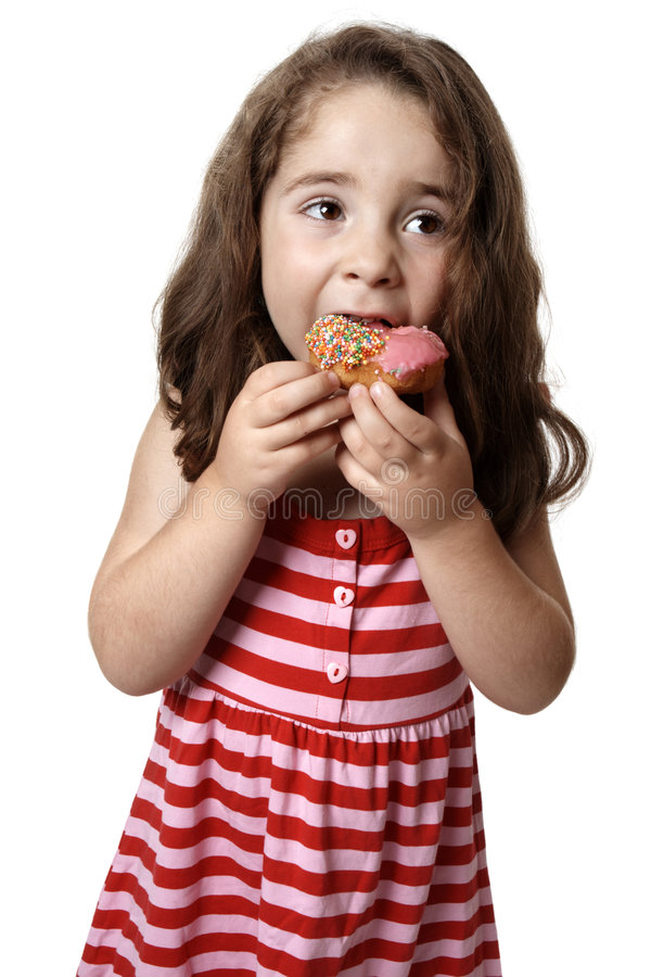 Download Young girl eating doughnut stock photo. Image of curly - 8322808