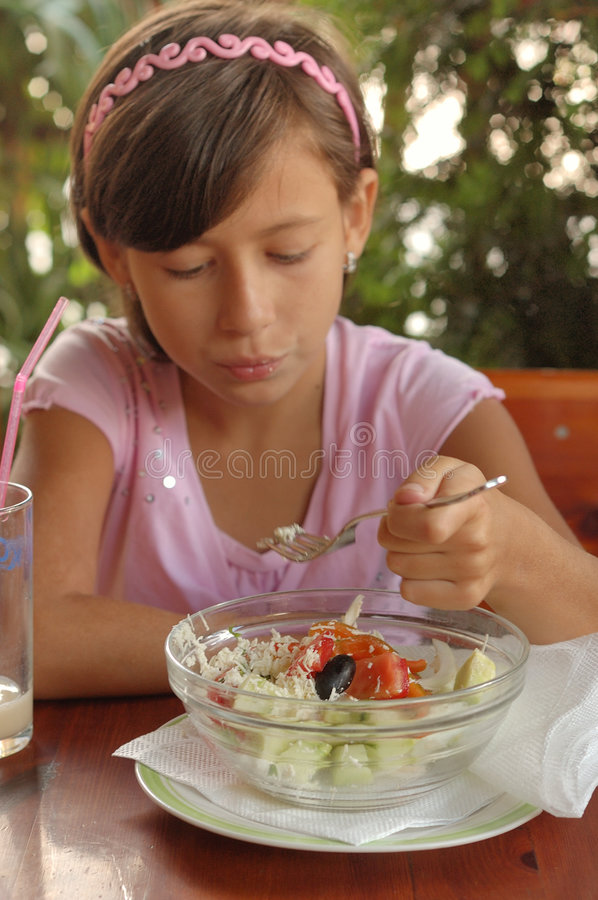 Download Young girl eating salad stock image. Image of napkin, healthy - 6377121