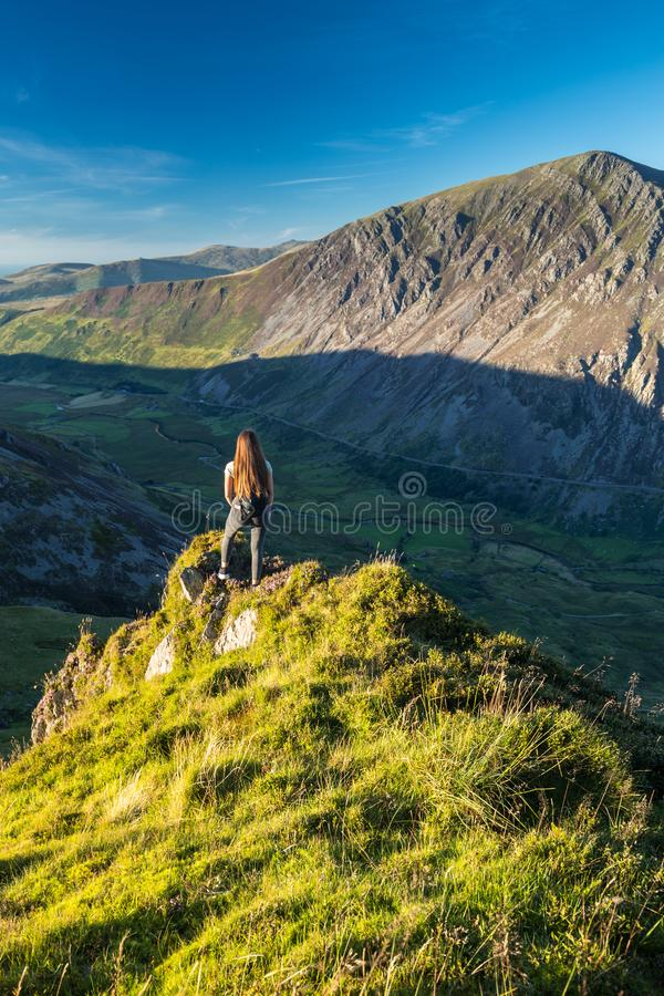 Young Girl on the Edge of Cliff royalty free stock photo