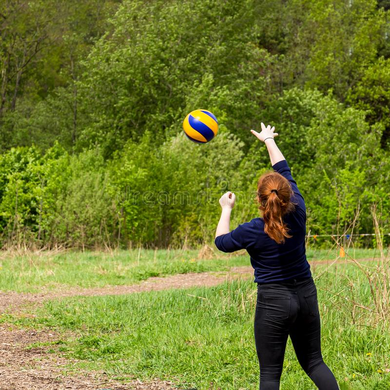 Young girl enjoy a healthy lifestyle while playing volleyball royalty free stock images