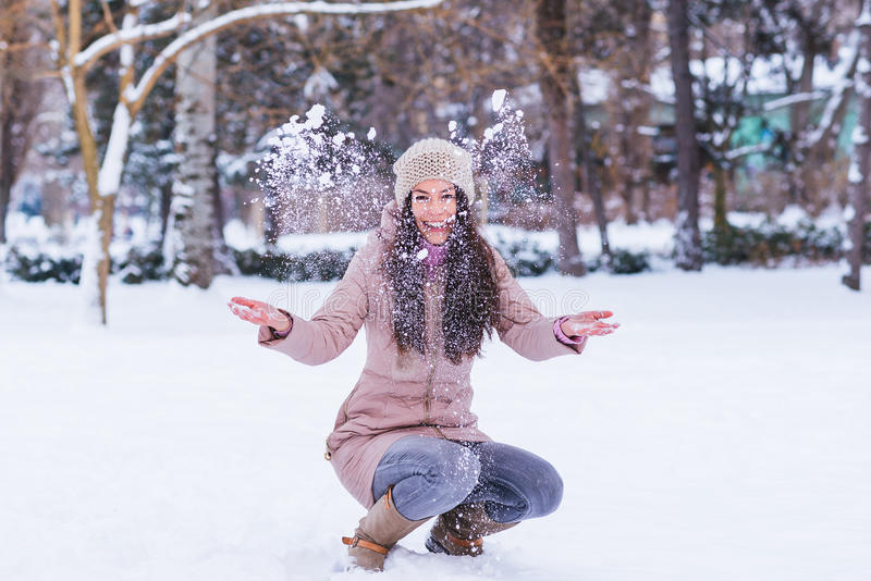 Young girl enjoy at winter time. Beautiful young long hair girl playing and enjoying on a winter time royalty free stock image