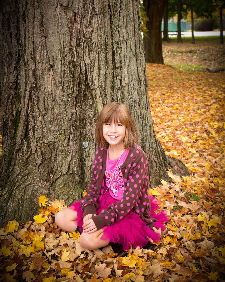 Young Girl Enjoying Autumn royalty free stock photography