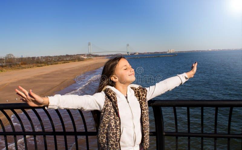 Young girl enjoying life. royalty free stock image