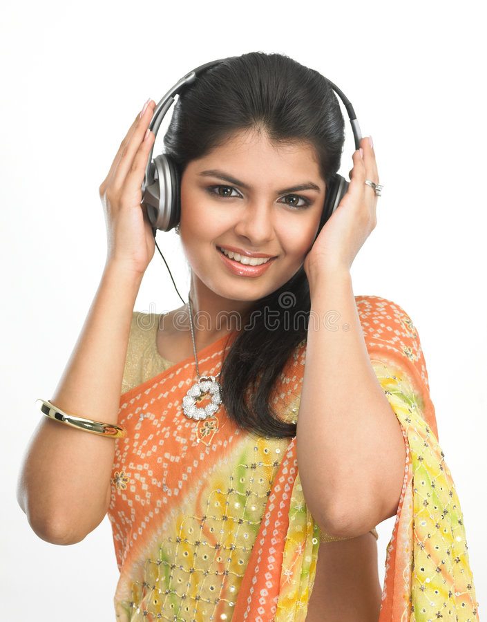 Young girl enjoying the music royalty free stock photography