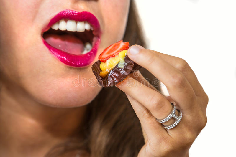 Pastry in mouth royalty free stock image