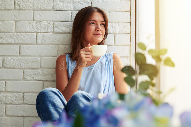Man Drinking Tea And Looking At A Woman Stock Image
