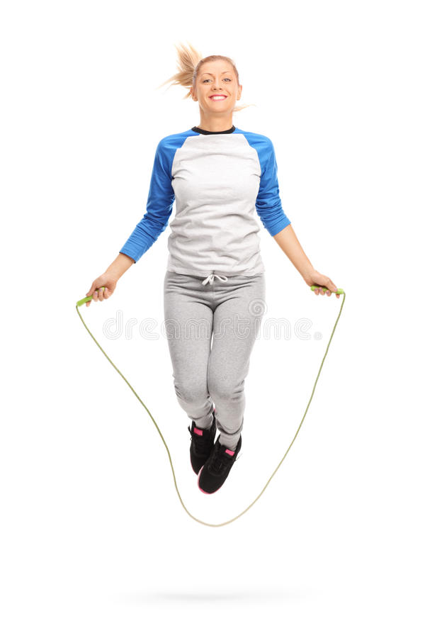 Young girl exercising with skipping rope stock image