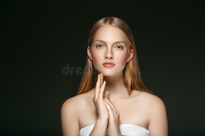 Young girl face beauty skin portrait with long blonde hair with royalty free stock image