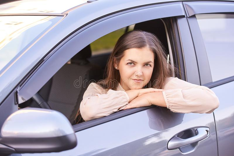 Young girl face. Rental car driver. buying new jeep.  stock photos