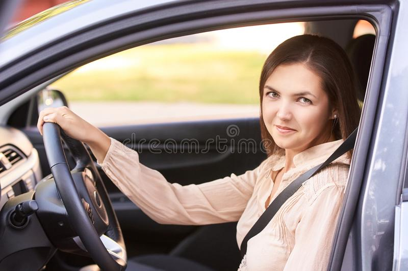 Young girl face. Rental car driver. buying new jeep.  stock photo