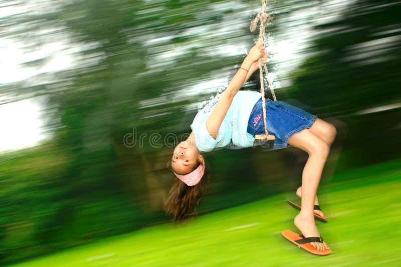 Young girl on fast swing royalty free stock photography