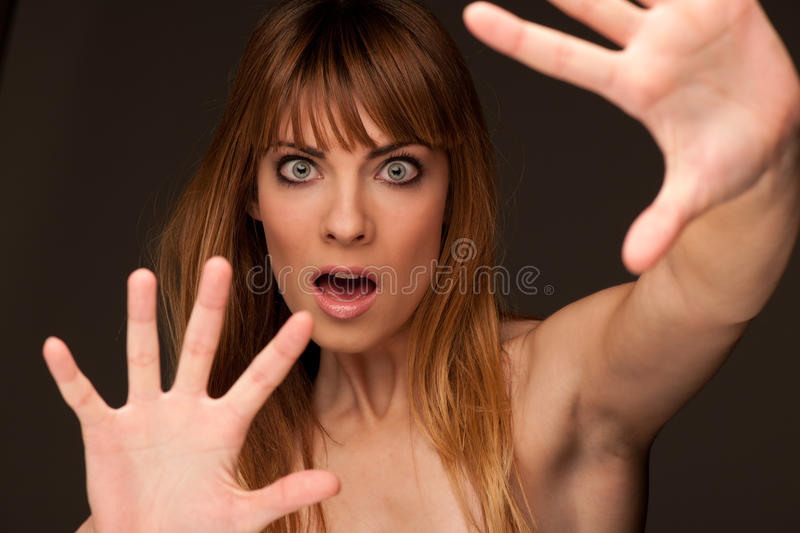 Young girl in fear-expression of panic royalty free stock photography
