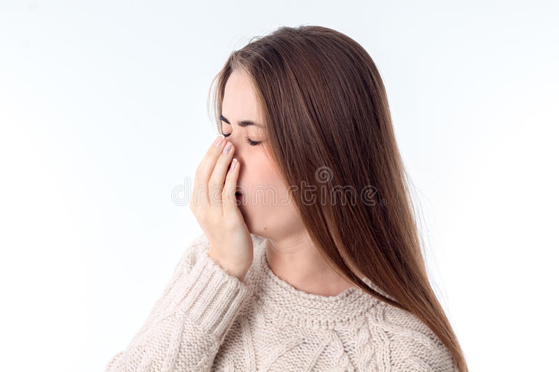 Young girl fell ill and coughing. Attractive young girl fell ill and coughing isolated on white background royalty free stock photography