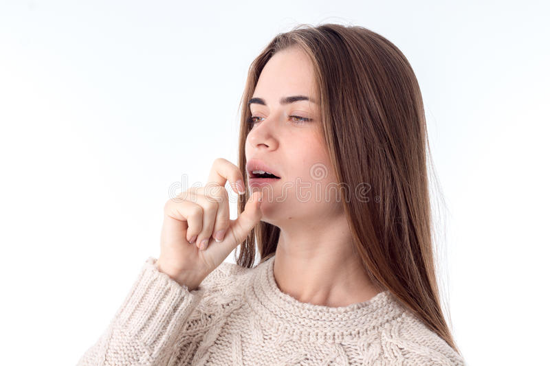 Young girl fell ill and coughing. Attractive young woman fell ill and coughing isolated on white background stock images