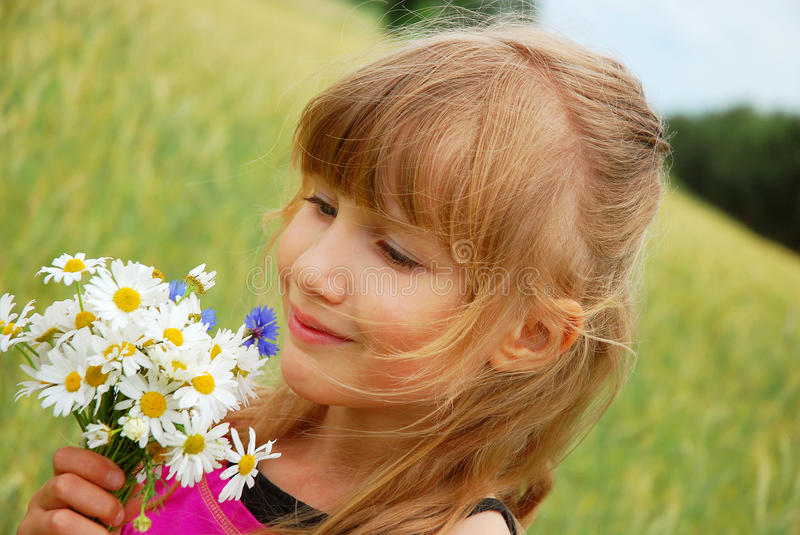 Young girl on field royalty free stock images