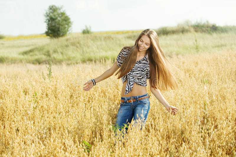 Download Young girl in the field stock photo. Image of hand, cheerful - 25895190