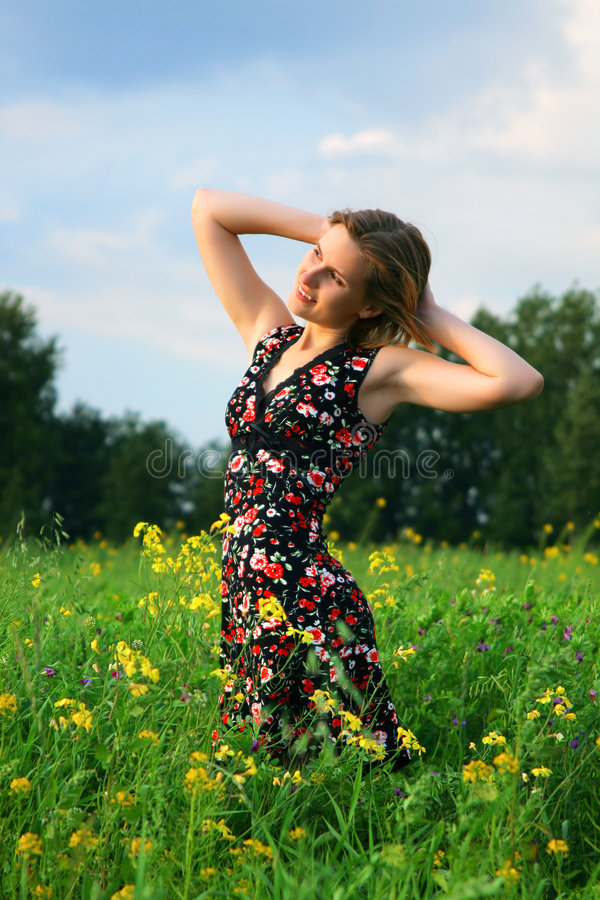 Young girl in field stock photo