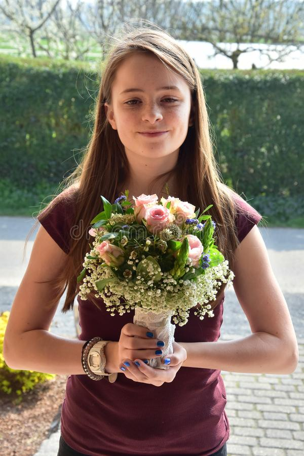 Young girl with flower bouquet royalty free stock photos