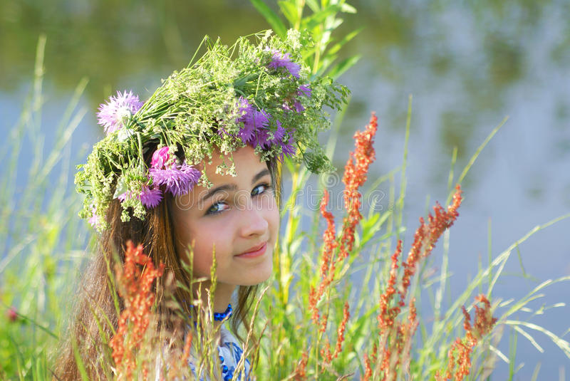 Young girl with flower garland royalty free stock image