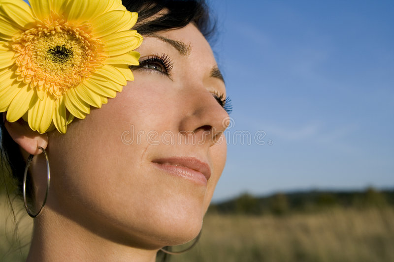 Young girl with flower- summer stock image