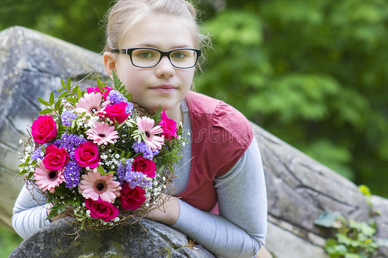 Young girl with flowers royalty free stock photography