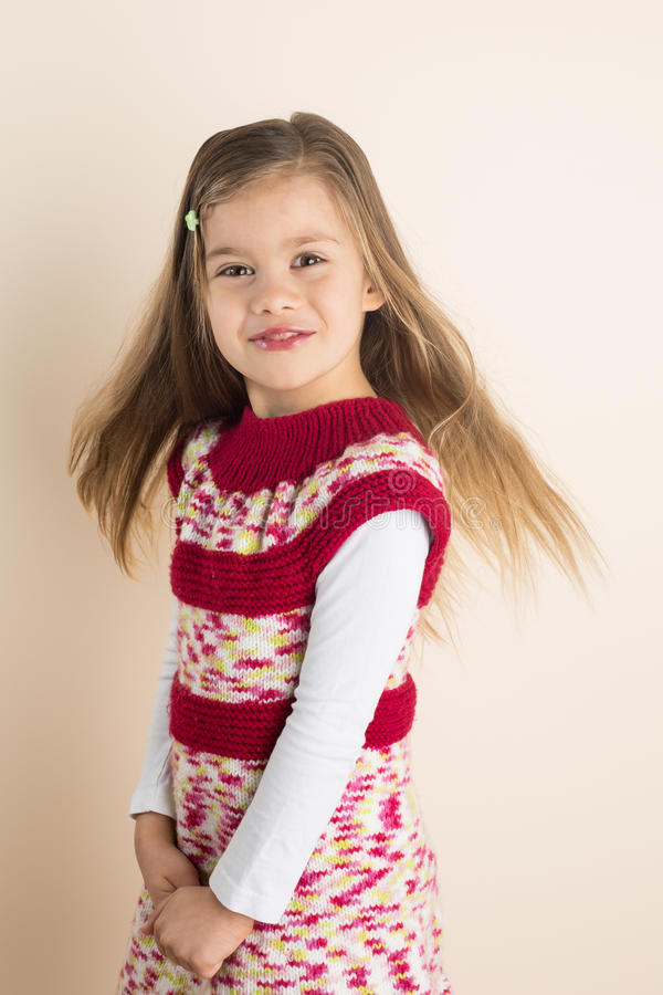 Young Girl with Flowing Hair, in Knitted Dress royalty free stock photo